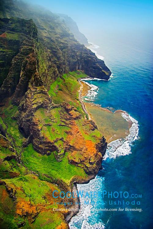 """Nu`alolo or Nu`alolo Valley, """"Fat Man's Misery"""" rock, coral reef and Nu`alolo Kai or Nualolo Kai beach, Na Pali coast, Kauai, Hawaii, Pacific Ocean"""