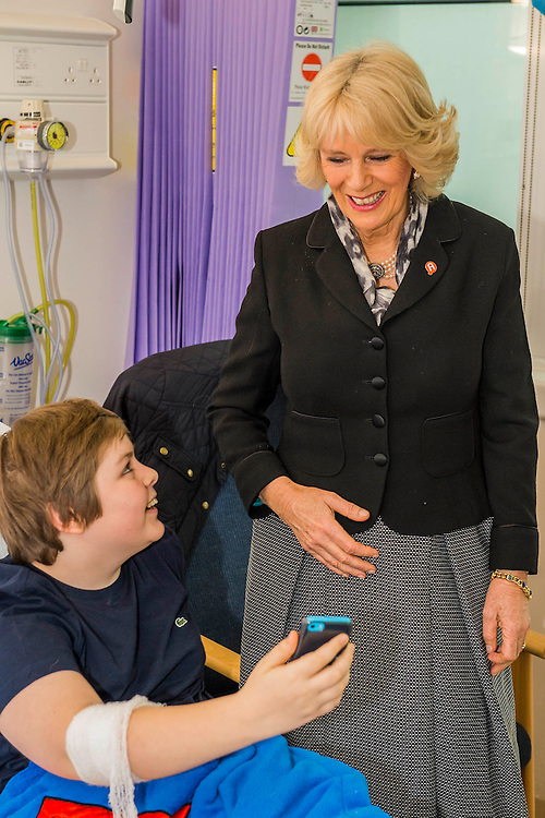Her Royal Highness meets Charley Saunders, 18 from Poplar, and Danny Roberts, 13 from Maida Vale (pictured taking a selfie with her), on the ward. The Duchess of Cornwall, Patron, Arthritis Research UK, visits and meets patients of the Adolescent Inpatient Unit at University College London Hospitals.  •Her Royal Highness then tours a laboratory at the Arthritis Research UK Centre for Adolescent Rheumatology and meeting researchers and supporters. London 12 Feb 2015.