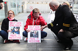 Campaigners for legalising medicinal cannabis Vera Twomey (centre) and Sarah Mahoney stage a sit down protest inside the gates of Leinster House, Dublin.