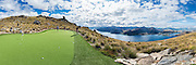 Helicopter Golf: A Par 3 in the Sky Overlooking Queenstown<br /> <br /> Nestled 4,500 feet up in the breathtaking southern Alps of New Zealand is an unforgettable par 3 golf experience overlooking Queenstown. Accessible only by helicopter, the hole features four different tee boxes located at varying distances and heights from the green.<br /> The Over the Top Golf experience is operated by the Over The Top helicopter company in association with the Golf Warehouse. 100% biodegradable, eco golf balls made from wood are recommended. These balls will float in water and can be reused, or will naturally degrade in 3-6 months.<br /> Specific site plans and resource consents took over a year to complete with helicopters ferrying earth moving equipment, men, sand and turf across Lake Wakatipu. Ecologists and conservation people were also flown to ensure that the pristine environment remained intact.<br /> the cost is $475 NZD per person.<br /> ©Over the top/Exclusivepix Media