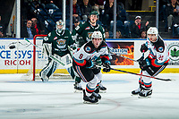 KELOWNA, BC - FEBRUARY 28: Mark Liwiski #9 of the Kelowna Rockets keeps his eye on the puck as he circles back out of the offensive zone against the Everett Silvertips at Prospera Place on February 28, 2020 in Kelowna, Canada. (Photo by Marissa Baecker/Shoot the Breeze)