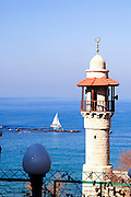 Israel, Jaffa, The turret of El Baher mosque and the Andromeda rock at the entrance to the harbour in the background..