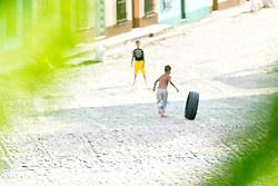 Children playing on the street of the colonial town of Trinidad, Cuba, listed as a UNESCO world heritage site.