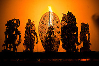 Wayang kulit or shadow puppet theater - Performances of shadow puppet theater are accompanied by gamelan in Indonesia. .Shadow puppets are a play of marionettes that dance and move about to tell a story on a blank screen through the movementof shadows, or bayan, and the movement of thepuppets themselves.The dalang orpuppeteer, who is often in a trance-like state, is the mythic storyteller and believed to be divinely inspired with 'sakti' or magical power which gives him the ability to tell stories of significance which oftenrecount the eternal struggle between good and evil.  UNESCO designated Wayang Kulit  as a Masterpiece of Oral and Intangible Heritage of Humanity in 2003.