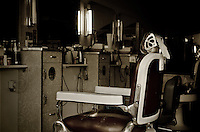 A local barbershop after closing showing the vintage decor that has been present for decades.