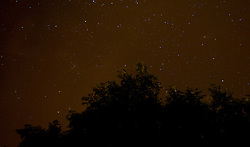 © Licensed to London News Pictures. 13/08/2012..Castleton, North Yorkshire, England..Over the last few evenings the Perseid Meteor Shower has been visible...Every meteor seen was once in the tail of the Comet Swift-Tuttle, a 27-kilometre-wide iceberg in space. ..It spends most of its time in the outer solar system, reaching beyond the orbit of Pluto. Then, every 133 years, it dives past the sun, replenishing the supply of Perseids...Swift-Tuttle, like all the comets, is in a constant state of disintegration. Comets hail from the outer solar system where icy compounds are easily maintained because it is so cold. As a comet approaches the sun the heat melts the ice and solid grains of dust are released into space. ..This creates the ephemeral tails that are seen stretching across the night sky. Earth will plough through the debris stream left by a giant comet that has been circling the sun since the birth of the solar system. ..Every single one of those meteors was born as the Earth was forming, about 4.5 billion years ago..Photo credit : Ian Forsyth/LNP