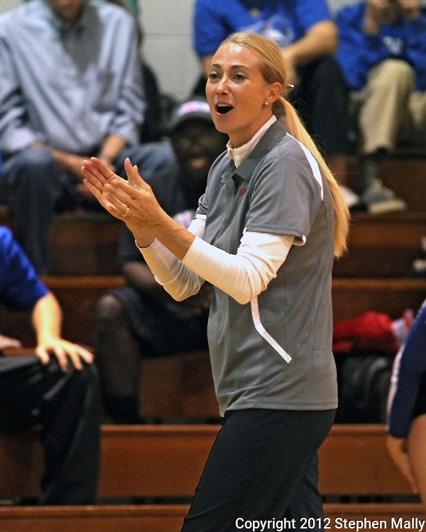 Washington head coach Kari Lombardi applauds her team during the MVC Volleyball Tournament semifinal game between the Wahlert Golden Eagles and the Washington Warriors at Kennedy High School in Cedar Rapids on Saturday October 13, 2012. Washington defeated Wahlert 25-13, 25-20.