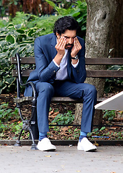 """British actor Dev Patel is seen with costar Catherine Keener filming their upcoming Amazon Series """"Modern Love"""" in Manhattan's Washington Square Park. Director John Carney is also seen talking with the two actors in between scenes. 21 Sep 2018 Pictured: Dev Patel. Photo credit: LRNYC / MEGA TheMegaAgency.com +1 888 505 6342"""