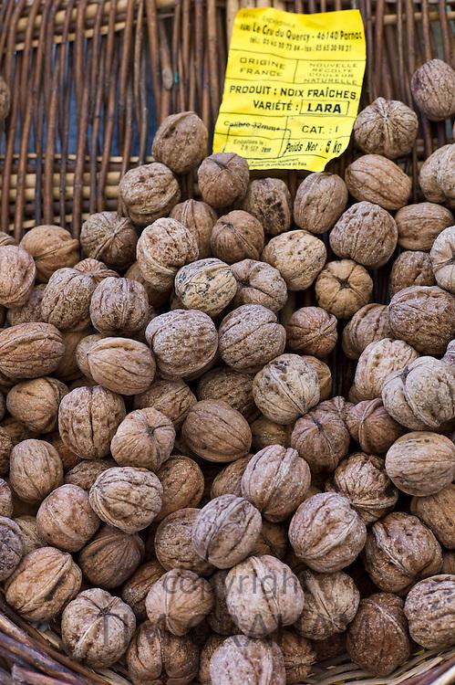 Fresh walnuts on sale at food market at La Reole in Bordeaux region of France