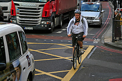 .Cyclists dodge through overcrowded roads during London Tube Strike. © under license to London News Pictures. 03/11/2010.Tube Strike, RMT and TSSA members strike over job cuts and safety issues.