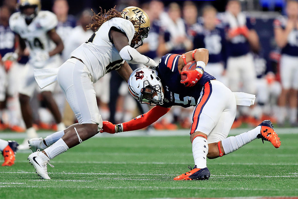 UCF Knights linebacker Shaquem Griffin (18) tackles Auburn Tigers running back Devan Barrett (5) during the 2018 Chick-fil-A Peach Bowl NCAA football game on Monday, January 1, 2018 in Atlanta. (Paul Abell / Abell Images for the Chick-fil-A Peach Bowl)