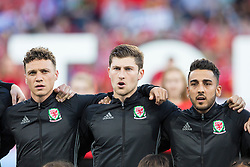 TOULOUSE, FRANCE - Monday, June 20, 2016: Wales players line-up to sing the national anthem ahead of the final Group B UEFA Euro 2016 Championship match against Russia at Stadium de Toulouse. L-R: James Chester, Ben Davies and Neil Taylor. (Pic by Paul Greenwood/Propaganda)