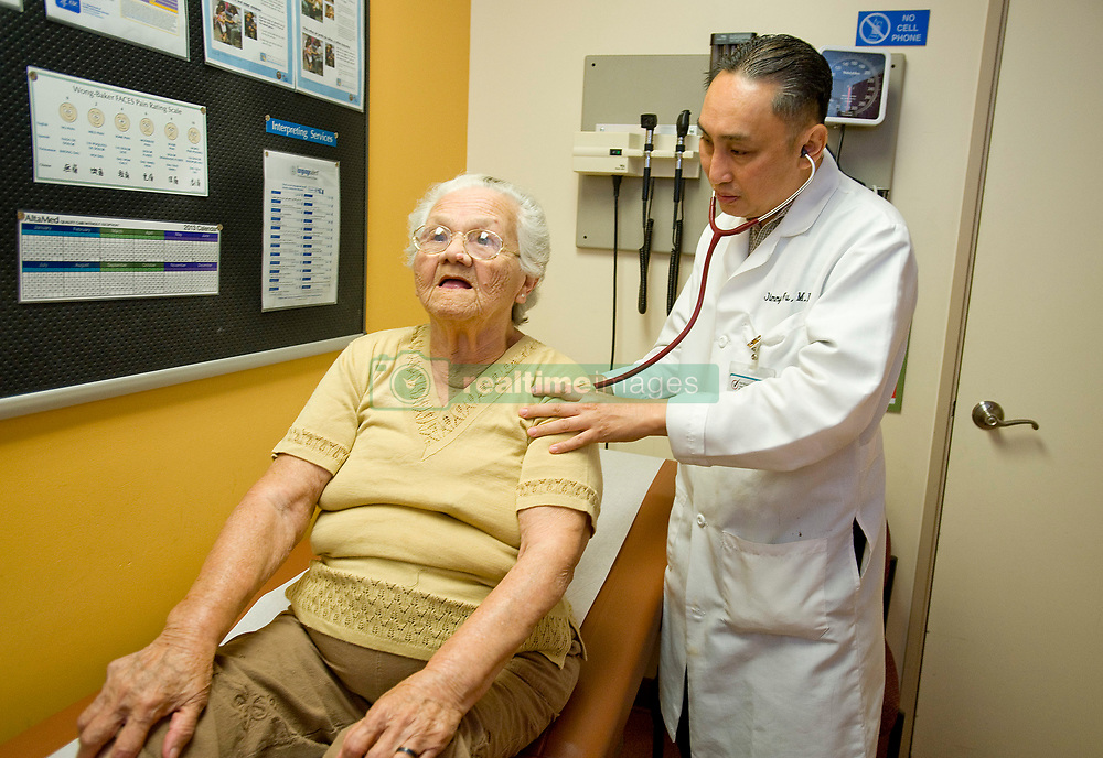 Aug. 15, 2013 - Garden Grove, California, U.S. - At AltaMed in Garden Grove, Doctor Jimmy Wu examines patient Yolanda Flores, 87.  The non  profit provider which sees an average of 125 patients a day in Garden Grove aims to care for  Latino, multi-ethnic and underserved communities in Southern California...///ADDITIONAL INFO ////  JEBB HARRIS ORANGE COUNTY REGISTER  -  focus.obamacare.0818.jah  - shot: .8/15/13 --   /// .AltaMed is a non profit health care provider who says, ''AltaMed  is prepared for the new Obama Care and Health Care Reform. The plan is in alignment with our mission statement which is to serve the underserved regardless of their pre-existing conditions and income.'' Photos were made at the Garden Grove Location on August 15, 2013. Keywords: obamacare, health, healthcare, doctor, medical, insurance, medical care, examination, treatment. (Credit Image: © Jebb Harris/The Orange County Register/ZUMAPRESS.com)