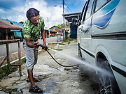 03 JUNE 2015 - KULAI, JOHORE, MALAYSIA:  A Rohingya refugee working at a car wash in Kulai, Malaysia. The UN says the Rohingya, a Muslim minority in western Myanmar, are the most persecuted ethnic minority in the world. The government of Myanmar insists the Rohingya are illegal immigrants from Bangladesh and has refused to grant them citizenship. Most of the Rohingya in Myanmar have been confined to Internal Displaced Persons camp in Rakhine state, bordering Bangladesh. Thousands of Rohingya have fled Myanmar and settled in Malaysia. Most fled on small fishing trawlers. There are about 1,500 Rohingya in the town of Kulai, in the Malaysian state of Johore. Only about 500 of them have been granted official refugee status by the UN High Commissioner for Refugees. The rest live under the radar, relying on gifts from their community and taking menial jobs to make ends meet. They face harassment from Malaysian police who, the Rohingya say, extort bribes from them.   PHOTO BY JACK KURTZ