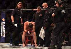 Darren Till recovers from being knocked out by Jorge Masvidal in their Welterweight bout during UFC Fight Night 147 at The O2 Arena, London.