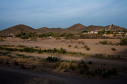 A view of the desert just outside of Altar, Sonora.  Altar is the starting point for many migrants' journeys to the US. In Altar they find guides and coyotes to take them across the border.  The town's economy is nearly entirely dependent on the migrants. Recently drug cartels have become involced in the smuggling of people, using the same routes as the drugs and charging the migrants an exit tax to leave the country.