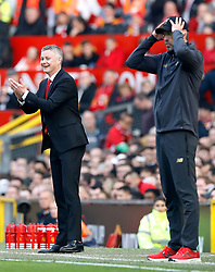 Manchester United caretaker manager Ole Gunnar Solskjaer (left) reacts from the touchline during the Premier League match at Old Trafford, Manchester.