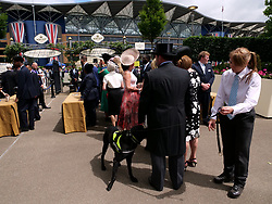 Racegoers pass through security during day one of Royal Ascot at Ascot Racecourse.