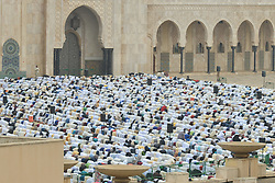 June 26, 2017 - Casablanca, Morocco - Moroccan Muslims gather to celebrate Eid al-Fitr Prayer in Casablanca's Hassan II mosque. Muslims around the world celebrate Eid al-Fitr marking the end of the fasting month of Ramadan..On Monday, June 26, 2017, in Casablanca, Morocco. (Credit Image: © Artur Widak/NurPhoto via ZUMA Press)