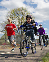 Students, faculty and parents from Pleasant Street School join for a bike ride from Laconia Middle School to the WOW Trail on Monday afternoon.  (Karen Bobotas/for the Laconia Daily Sun)