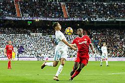 (L-R) Achraf Hakimi of Real Madrid, Lionel Jules Carole of Sevilla FC during the La Liga Santander match between Real Madrid CF and Sevilla FC on December 09, 2017 at the Santiago Bernabeu stadium in Madrid, Spain.
