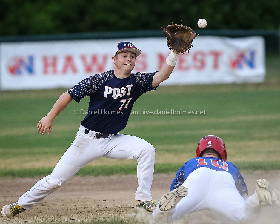 (6/27/16, NATICK, MA) Ashland Post 77's Mike Messier gets the runner out at second during the American Legion baseball against Natick Post 107 at Natick High School in Natick on Monday. Daily News and Wicked Local Photo/Dan Holmes