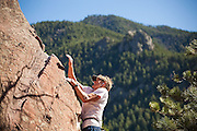 """Will Levandowski sets a new record for most vertical feet climbed in 24 hours on a boulder at Fagstaff in Boulder, Colorado. Levandowski climbed 2883 laps on a 10' 1.25"""" rock, a total of 29130.3 feet, several feed higher than Mount Everest (29,029 ft). The minimum requirement from Guinness World Records was 25,000."""