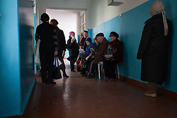 Patients wait for their appointment with a doctor at an MSF mobile clinic set up in a Ukrainian polyclinic in the town of Sukodolsk near to Lugansk. Many polyclinics in the area are unable to provide services to patients due to a the unavailability of medical staff and drug shortages following the conflict with Ukraine.