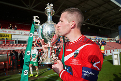 WREXHAM, WALES - Monday, May 2, 2016: The New Saints' captain goalkeeper Paul Harrison celebrates by kissing the trophy after the 2-0 victory over Airbus UK Broughton during the 129th Welsh Cup Final at the Racecourse Ground. (Pic by David Rawcliffe/Propaganda)