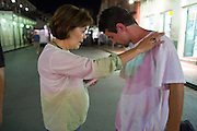 19 SEPTEMBER 2006 - NEW ORLEANS, LOUISIANA: MIREYA GROS, from the Vieux Carre Assembly of God Church in the French Quarter prays with a passerby on Bourbon Street in New Orleans. Photo by Jack Kurtz / ZUMA Press