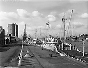 """13/02/1958<br /> 02/13/1958<br /> 13 February 1958<br /> Docks strike: Dublin Port and Alexandra Basin Dock Strike. The docks lie deserted during the strike with a view of the """"Emmy S."""" out of Groningen, and other ships."""
