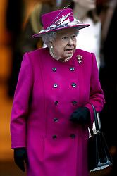 Britain's Queen Elizabeth II leaves the British Museum in London after a short visit where she reopened the Sir Joseph Hotung Gallery.