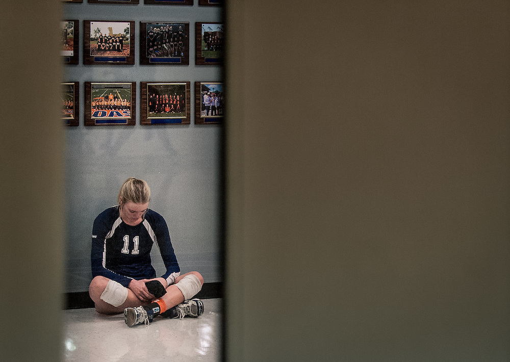 Orange Coast College Volleyball's Kellie Kleszcz mentally prepares for her game against Golden West College in Costa Mesa, CA on Nov 7, 2014.