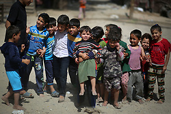 May 22, 2019 - Gaza, gaza strip, Palestine - Palestinian children pose for a picture outside a house in an impoverished area in Beit Lahia in the northern Gaza Strip on May 22, 2019. (Credit Image: © Majdi Fathi/NurPhoto via ZUMA Press)