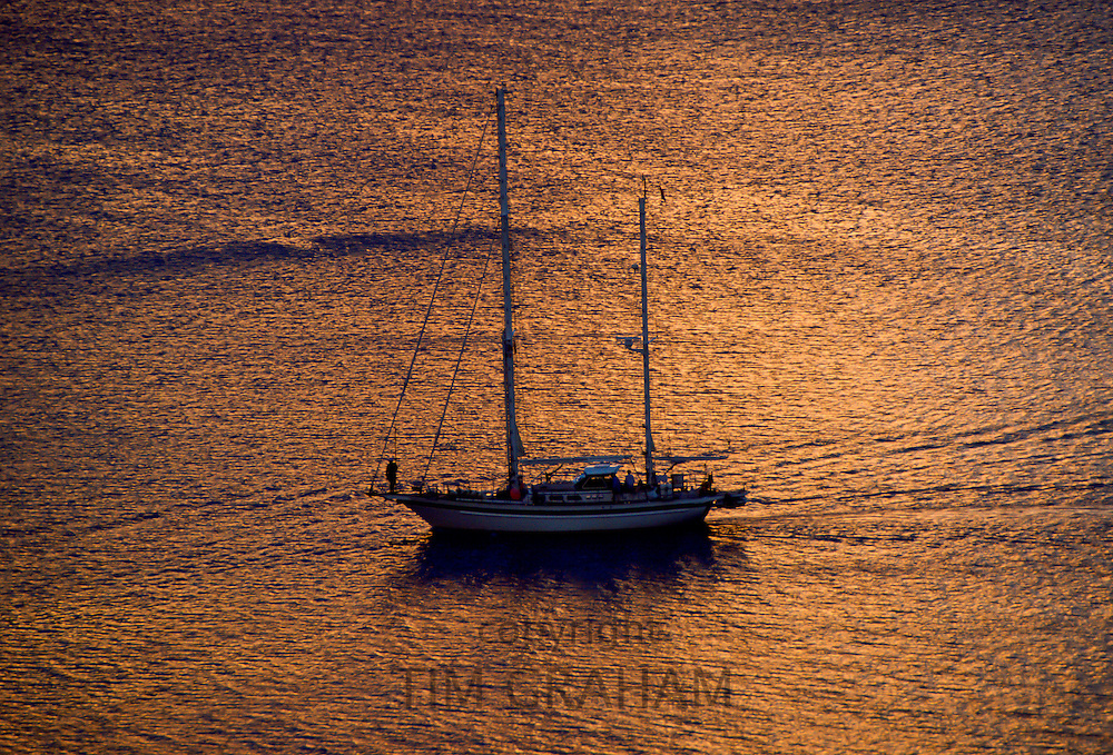 Lone yacht in the Lesser Antilles, Caribbean Islands RESERVED USE - NOT FOR DOWNLOAD -  FOR USE CONTACT TIM GRAHAM