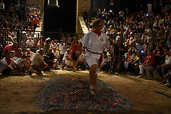 June 24, 2017 - San Pedro Manrique, Soria, Spain - A reveler walks on burning embers during the celebration of 'Paso del Fuego' (Fire Walk) on Saint John's night in San Pedro Manrique, Soria province, in northern Spain. (Credit Image: © Jorge Sanz/Pacific Press via ZUMA Wire)