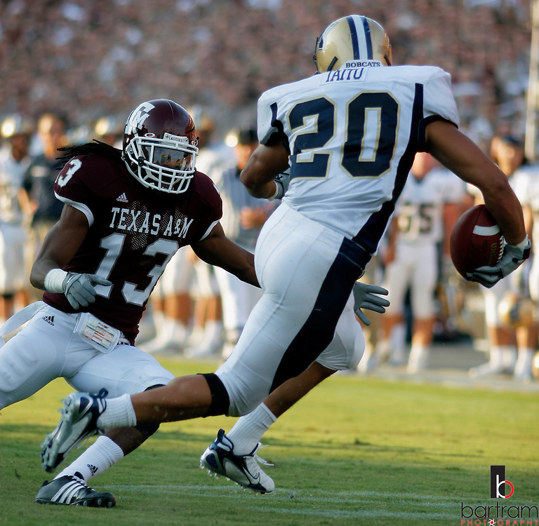 Texas A&M defensive back Marquis Carpenter reaches for Montana State's Usauag Tauti during the third quarter on Saturday, Sept. 1, 2007 in College Station, TX. Texas A&M won the game 38-7.