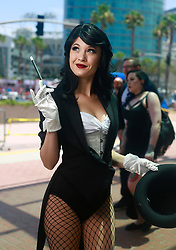 July 20, 2017 - San Diego, CA, USA - Hendo Art of Los Angeles dressed a Zatanna from Justice League at Comic-Con in San Diego. (Credit Image: © K.C. Alfred/San Diego Union-Tribune via ZUMA Wire)