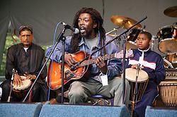 Three musicians performing at the Nottingham Mela,