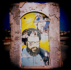 A damaged depiction of Hezbollah leader Sayyid Hassan Nasrallah remains in the center of Bint Jbeil, Southern Lebanon, Oct. 23, 2006.  <br />Bint Jbeil was claimed by Hezbollah to be the center of their resistance movement.