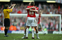 Photo: Rich Eaton.<br /> <br /> Grimsby Town v Cheltenham Town. Coca Cola League 2. Play off Final. 28/05/2006. Brian Wilson and Mickey Bell of Cheltenham celebrate victory and promotion to league 1 as the referee blows the final whistle