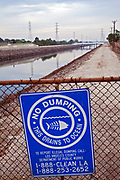 No Dumping in ocean sign along Dominguez Channel, a 15.7 mile stream that drains the Dominguez Watershed, going from its headwaters in Hawthorne and it emptying into the East Basin of the Port of Los Angeles. Carson, California, USA