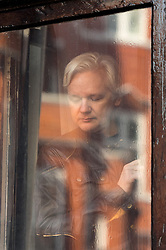 Julian Assange steps out onto the balcony of the Ecuadorian embassy in London after a seven-year investigation in Sweden against the WikiLeaks founder was suddenly dropped.