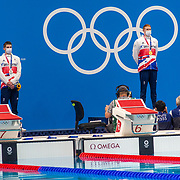 TOKYO, JAPAN - JULY 27: Tom Dean of Great Britain with his gold medal on the podium with silver medal winner and team mate Duncan Scott of Great Britain after the 200m freestyle for men during the Swimming Finals at the Tokyo Aquatic Centre at the Tokyo 2020 Summer Olympic Games on July 27, 2021 in Tokyo, Japan. (Photo by Tim Clayton/Corbis via Getty Images)