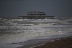 © Licensed to London News Pictures. 27/10/2013. BRIGHTON, UK Waves pound the old pier. Waves at Brighton seafront this morning as Britain was braced for the worst storm for a decade today, which is set to bring driving rain and winds of up to 90mph to some areas. Photo credit : LNP