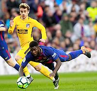 FC Barcelona's Samuel Umtiti (r) and Atletico de Madrid's Antoine Griezmann during La Liga match. March 4,2018. (ALTERPHOTOS/Acero)