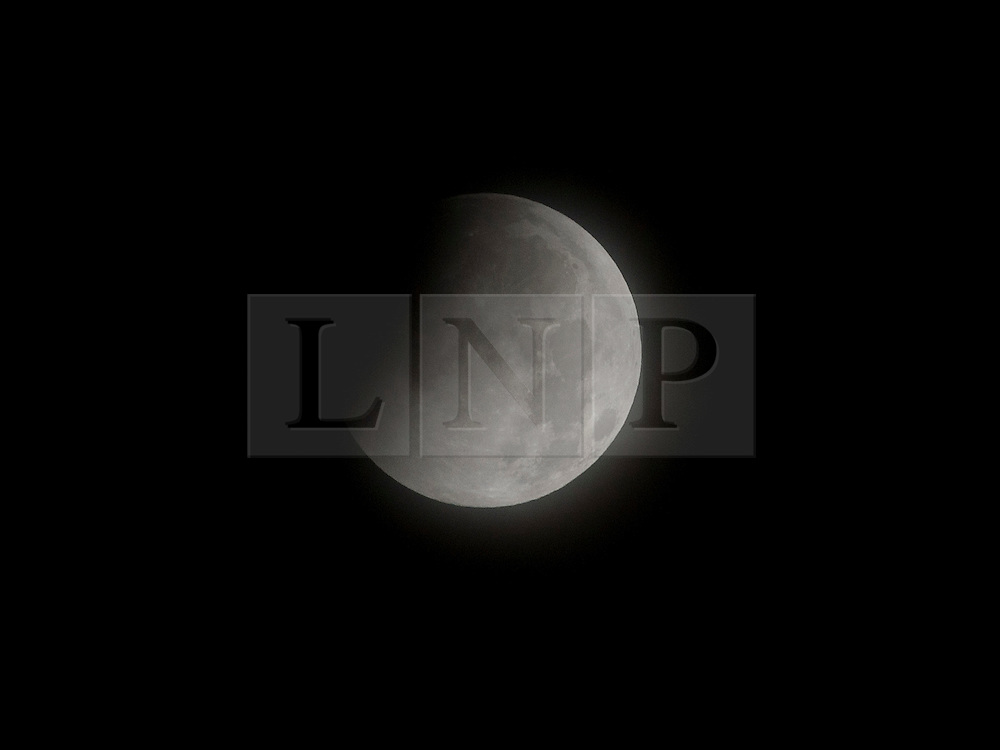 © under license to London News Pictures.  The moon begins to pass through the Earth's shadow at the start of lunar eclipse as seen from New Paltz, New York, USA. Photo credit should read Michael Graae/London News Pictures