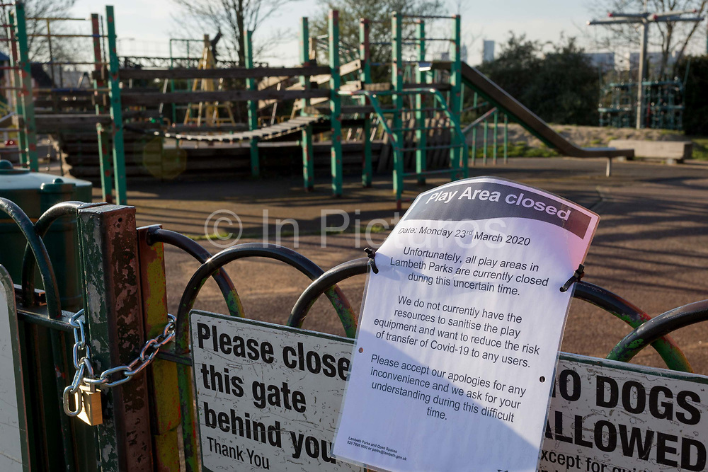 After a weekend of large numbers of Britons leaving London for holiday resorts and coastal beauty spots, and crowding into the capitals parks, the UK government is considering further restrictions of movement in public places to help social distancing during the Coronavirus pandemic. Some public green spaces have been closed by their own local authority but most, are still open with the exception of playparks like this in Ruskin Park, Herne Hill, on 23rd March 2020, in London, England.