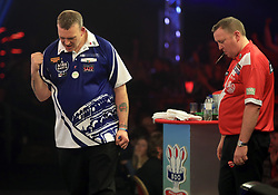 Mark McGeeney (left) reacts as Glen Durrant struggles to watch during day nine of the BDO World Professional Darts Championship 2018 at The Lakeside, London.