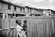 """BIRMINGHAM, AL – MAY 20, 2016: Marquita Smiley, 33, holds her 2-year-old son, Zaidan, in the backyard.<br /> <br /> While pregnant in 2014, Marquita Smiley was prescribed Zofran to help her cope with severe morning sickness. At her 20 week ultrasound, the OB/GYN discovered signs that her son was suffering from hypoplastic left heart syndrome – a rare heart defect resulting in a severely underdeveloped heart. Months later, her newborn Zaidan was placed on a transplant list, and he ultimately underwent surgery as a 2-month-old to replace the failed organ.<br /> <br /> Initially developed as a drug to help cancer patients suffering from the side-effects of chemotherapy, Zofran (generic name ondansetron) has become widely prescribed by doctors to treat morning sickness among pregnant mothers. Pharmaceutical companies point to studies that deny any link between the drug and birth defects, yet somehow ondansetron has avoided the strict barrier of clinical trials required by the Food and Drug Administration to validate its use among pregnant women. Absent of any data, critics argue that pregnant women and their babies are susceptible to unknown risks.<br /> <br /> It wasn't until months after Zaidan's heart transplant that the Zofran controversy was brought to Marquita Smiley's attention. """"Mentally more than anything it was life changing,"""" Smiley said. """"We watched him code several times, so I really don't want anybody to have to experience this. If [the drug] is what caused it, people need to know what they're getting into."""""""